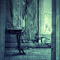 Hands On Window Of Creepy Old House by Jill Battaglia