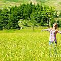 Happy girl enjoying nature Print by Anna Omelchenko