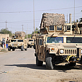 Humvees Conduct Security by Stocktrek Images
