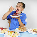Hungry Boy Eating Lot Of Cake by Matthias Hauser