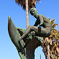 Huntington Beach Surfer Statue by Paul Velgos