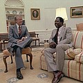 Jimmy Carter Chatting With Hank Aaron by Everett