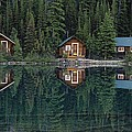 Lake Ohara Lodge Cabins Reflected Print by Michael Melford
