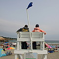Lifeguards Watch Over The Traditional by Stephen St. John