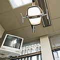 Looking Up At A Dentistry Light by Andersen Ross