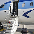 Luggage Near Airplane Steps by Jaak Nilson