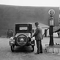 Man Fueling His Car At A Self-service by Everett