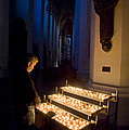 Man Prays By Candles At Frauenkirche by Greg Dale