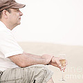 Man With Glass Of Champagner In The Dunes by Iryna Shpulak