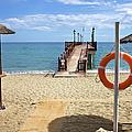 Marbella Beach In Spain by Artur Bogacki