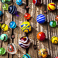Marbles On Wooden Board by Garry Gay