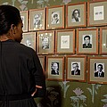 Michelle Obama Looks At Pictures by Everett