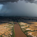 Monsoon Rains Over A Muddy River by Randy Olson