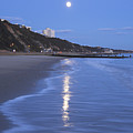 Moon Reflecting In The Sea, Bournemouth Beach, Dorset, England, Uk by Peter Lewis