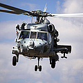 Navy Pilots In A Sh-60f Seahawk Conduct by Michael Wood