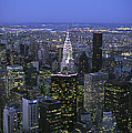 Night View Of The Manhattan Skyline by Todd Gipstein