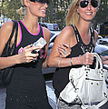 Paris Hilton, Nikki Hilton Carrying by Everett