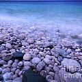 Pebble shore of Georgian Bay in winter Print by Oleksiy Maksymenko