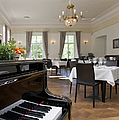 Piano In A Upscale Dining Room by Jaak Nilson