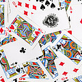 Pile Of Playing Cards by Wingsdomain Art and Photography