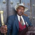 Portrait of a man wearing a 1930s-style suit and smoking a cigar in Havana Print by Sami Sarkis