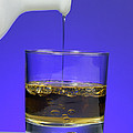 Pouring Oil Into Vinegar by Photo Researchers, Inc.