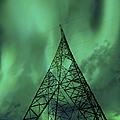 Powerlines And Aurora Borealis by Arild Heitmann