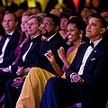 President And Michelle Obama Listen by Everett