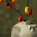 Pumpkin On A Stick In An Old Primitive Moonshine Jug by Kathy Clark