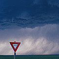 Rain Pours Out Of Dark Clouds On Plains by Carsten Peter