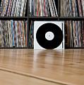 Records Leaning Against Shelves by Halfdark