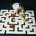 Researcher Testing Lego Robots Playing Pacman by Volker Steger