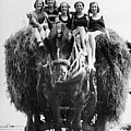 Ride On A Hay Cart by Fox Photos