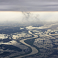 River Running Through A Flooded Countryside by Jeremy Woodhouse