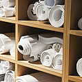 Rolls Of Blueprints In Cubbyholes by Jetta Productions, Inc