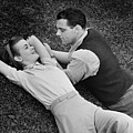 Romantic Couple Lying On Grass, (b&w), Elevated View by George Marks