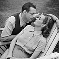 Romantic Couple Relaxing On Deckchair, (b&w) by George Marks