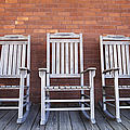 Row Of Rocking Chairs by Skip Nall