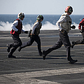 Sailors Clear The Landing Area by Stocktrek Images