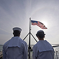Sailors Stand By To Lower The Ensign by Stocktrek Images