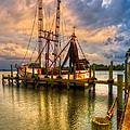 Shrimp Boat At Sunset by Debra and Dave Vanderlaan