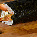 Shrimp Sushi Roll On Cutting Board by Carolyn Marshall