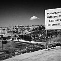 sign overlooking pyla and turkish controlled territory marking entrance of SBA Sovereign Base area by Joe Fox
