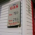 Signs On A Historic Gas Station Offer by Amy White & Al Petteway