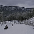 Snowmobilers In Yellowstone National by Raymond Gehman