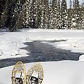 Snowshoes By Snowy Lake Lake Louise by Michael Interisano