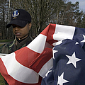Soldier Unfurls A New Flag For Posting by Stocktrek Images