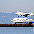 Star Alliance Airlines And Frontier Airlines Jet Airplanes At San Francisco Airport . Long Cut by Wingsdomain Art and Photography