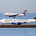 Star Alliance Airlines And Frontier Airlines Jet Airplanes At San Francisco International Airport by Wingsdomain Art and Photography
