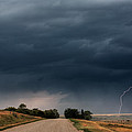 Storm Clouds And Lightning Along A Saskatchewan Country Road by Mark Duffy
